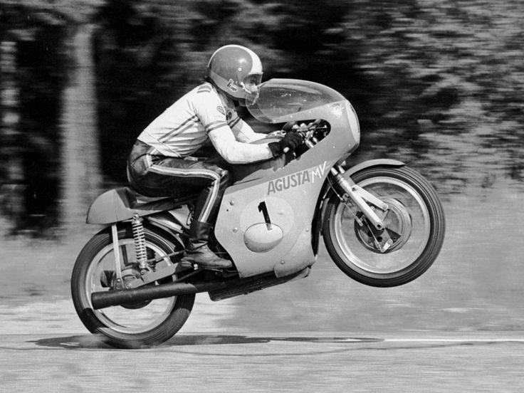 Giacomo Agostini on #1 MV Agusta. Boring wheelie. Better pic further down.