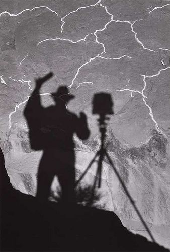 Ansel Adams, Self-portrait, Monument Valley, Utah, 1958 | I like this image because it shows the making of the photo (him stood taking it and the set up) and the photo itself. Almost a behind the scenes effect.