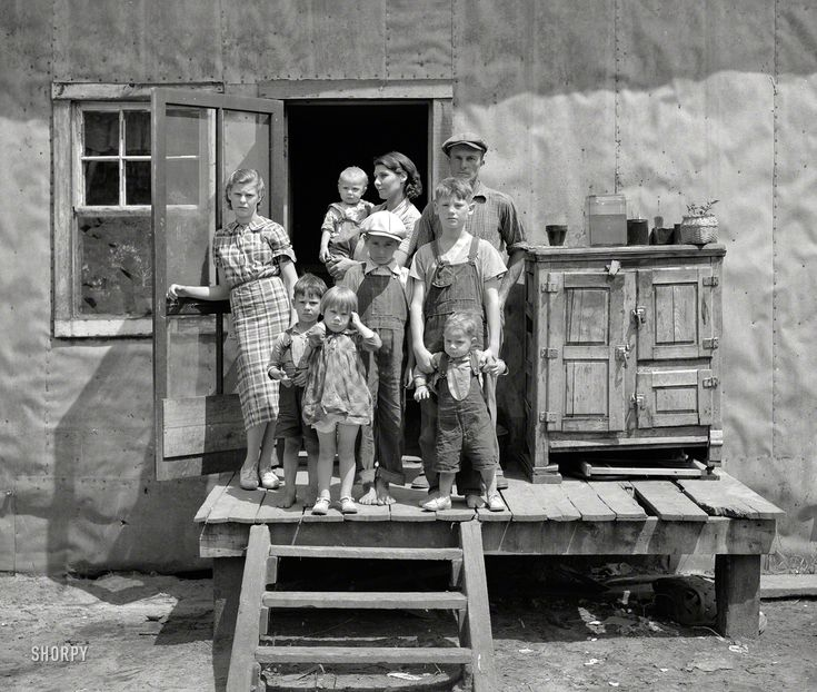 "All the Allens: 1937: ""Ray Allen family near Black River Falls, Wisconsin."" The semi-crossed eyes of the center boy caught my attention first, then the oldest boy holding onto the young child. What an accomplishment it must have been to get those 6 rambunctious children in position for a picture !  Medium format negative by Russell Lee."