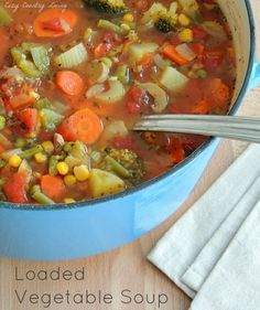 Loaded Vegetable Soup Ingredients  2 - 3 Tbsp. olive oil 4 large carrots, sliced 1/2 bunch of celery with leaves, chopped 2 medium sized oni...