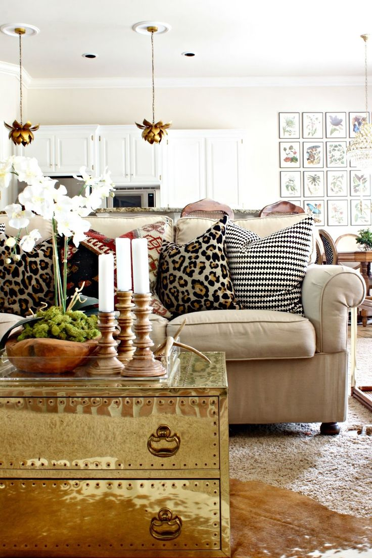 Fall decor || brass lotus pendants || brass trunk coffee table || black and white, leopard, and kilim pillows || cowhide rug || neutral with pops of color || botanical gallery wall