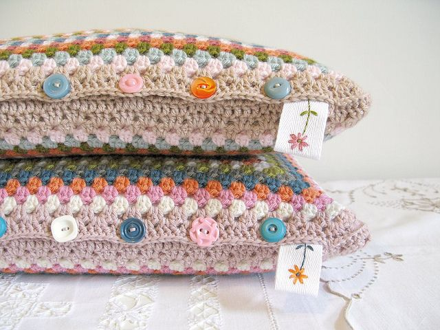 Crochet granny square pillows. Adorable. Love the colors and buttons. No pattern... Pinned for button join