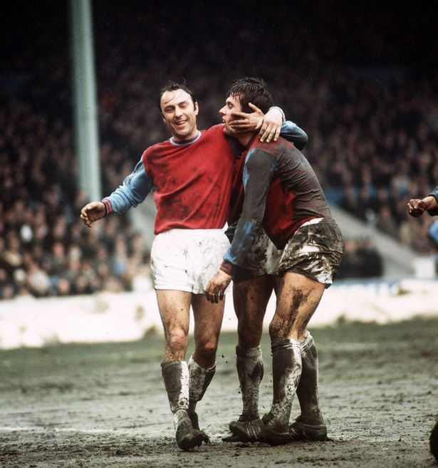 21st March 1970. Geoff Hurst with West Ham team-mate Jimmy Greaves on a Maine Road mud bath in which the Hammers won 5-1.