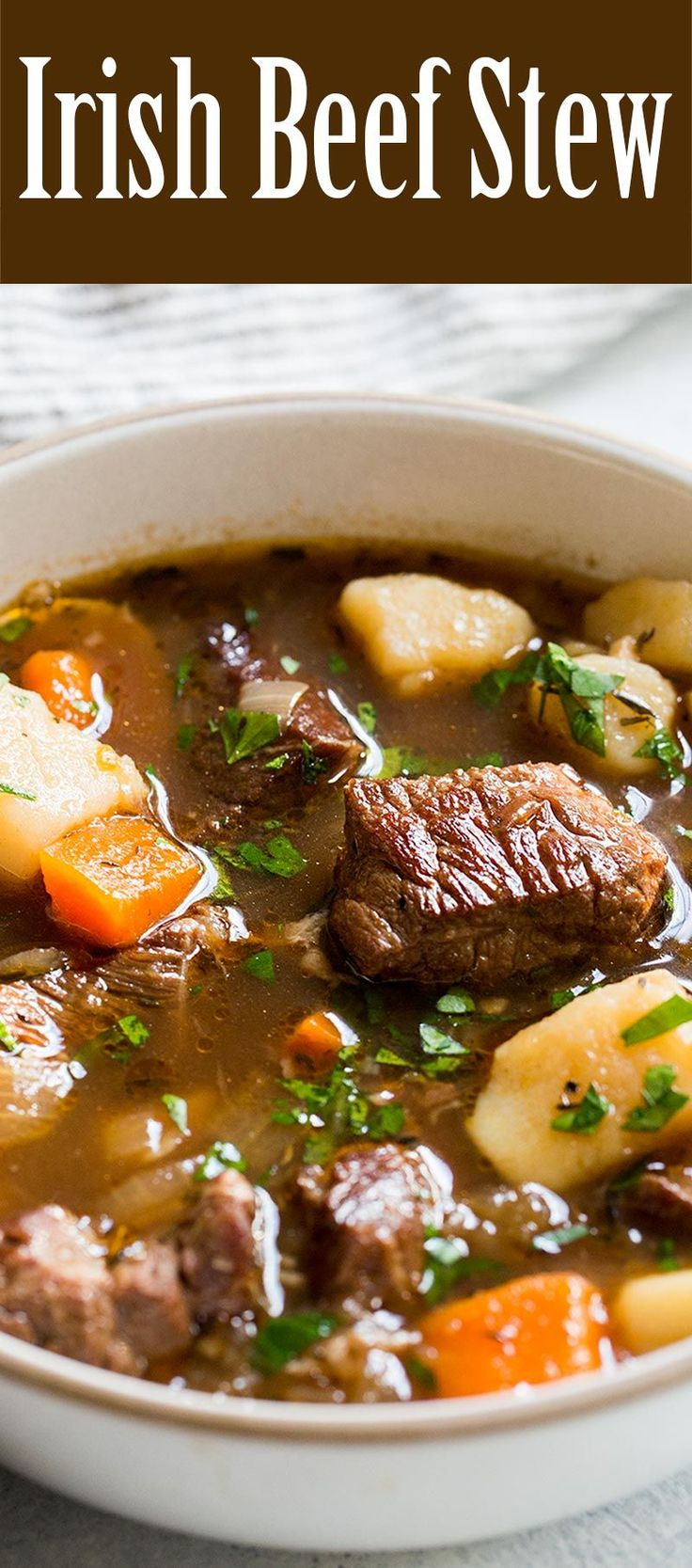 BEST Irish Beef Stew! Made with beef, garlic, stock, Irish Guinness stout, red wine, potatoes, carrots, and onions. A hearty stew perfect for celebrating St. Patrick's Day! #BeefStew #IrishStew #Irish #StPatricksDay