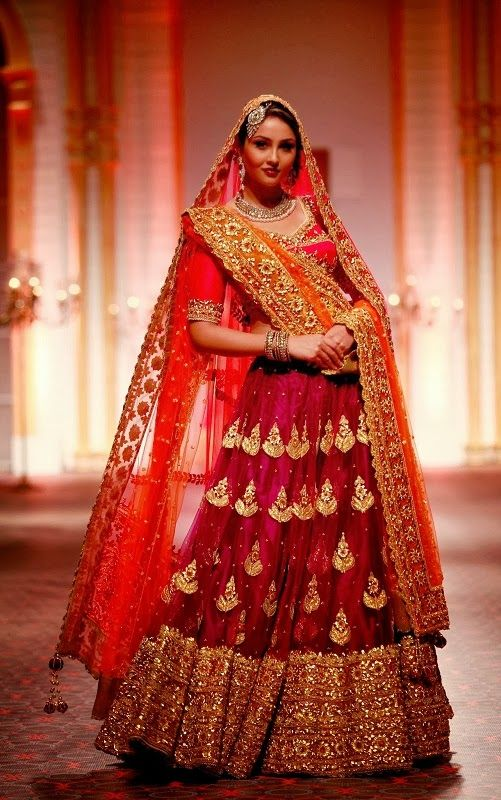 Gorgeous red and gold lehenga with an orange dupatta