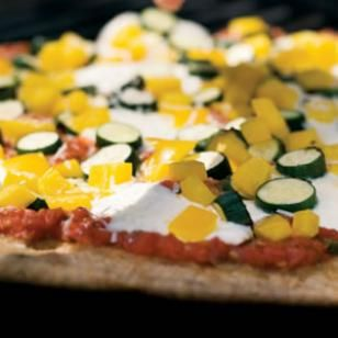 Bell pepper, zucchini and a fresh tomato sauce give this vegetarian pizza a taste of summer.