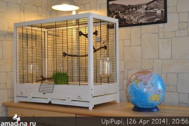 Ferplast GIULIETTA 5  Размеры 69 x 34,5 x h 58 см В комплекте: Две наружные поворотные кормушки Поилка Прищепка Качели Сборная жердочка для птиц