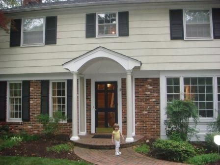 Portico Added To Update Garrison Style Home Curb Appeal