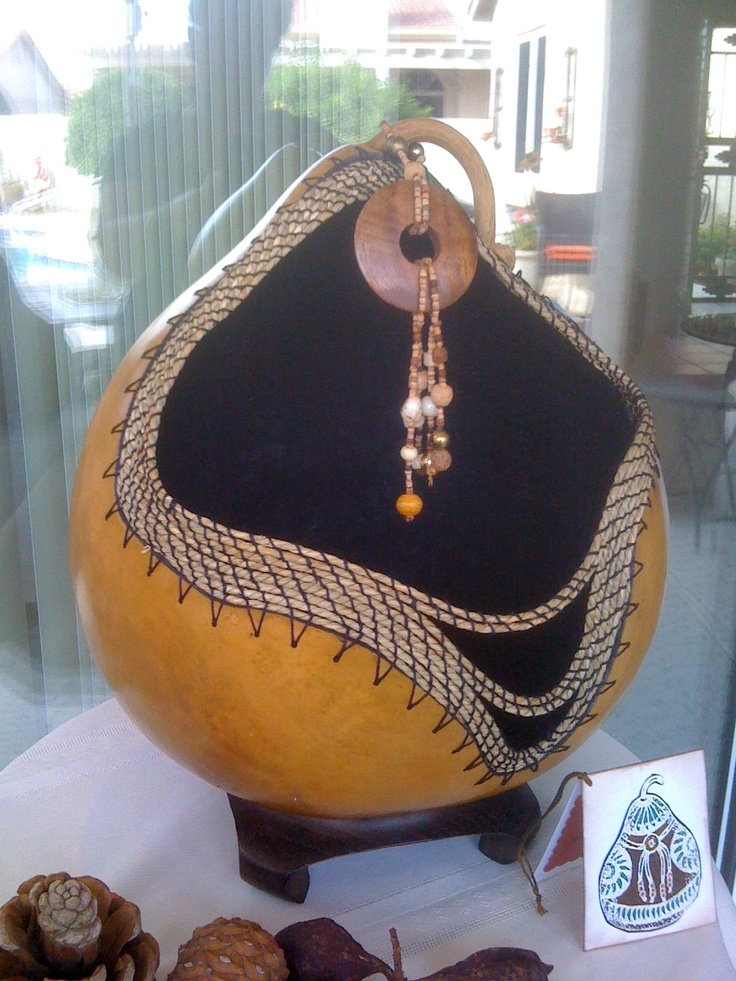 coiling on a golden gourd  by Carol Reese