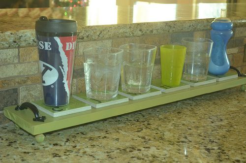 "Each family member has a ""coaster"" to place their glass for the day. No more ""grab a glass  put in the sink"" 50 x's a day! Great idea!"