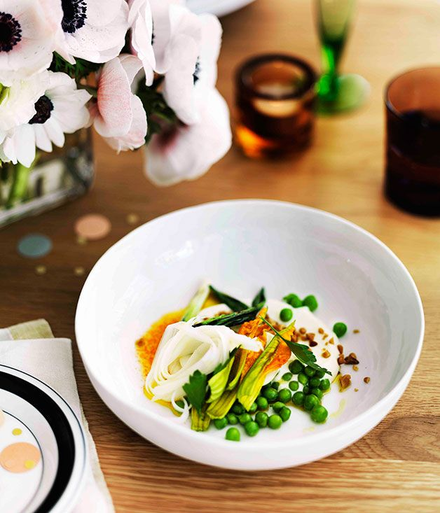 Recipe for pea salad, curd, pine nuts, blossoms, white asparagus and carrot juice dressing by Ross Lusted from Sydney's The Bridge Room restaurant.