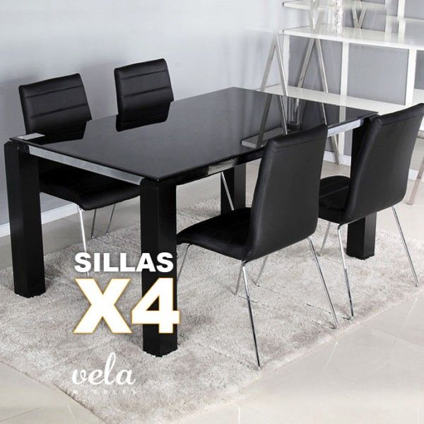 Conjunto de mesa para comedor totalmente negra y sillas decoradas con costuras horizontales.