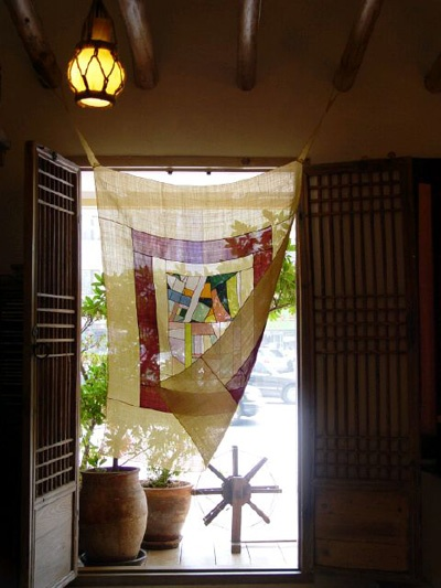 Korean bojagi textile used as curtain - this is so pretty!