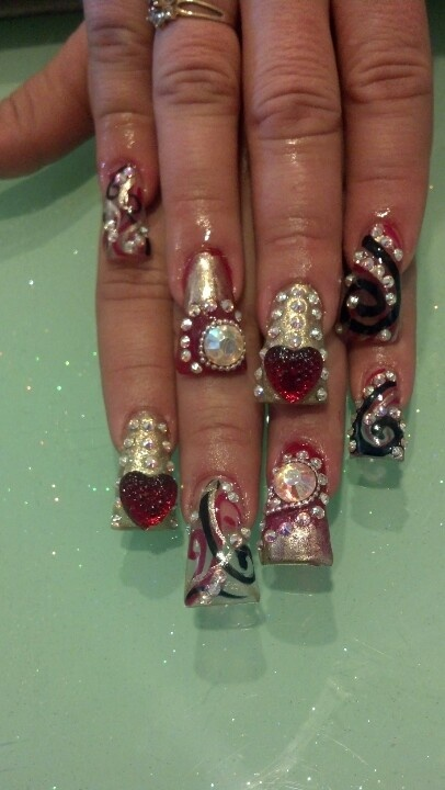 Long fan- tipped nails with extra bling