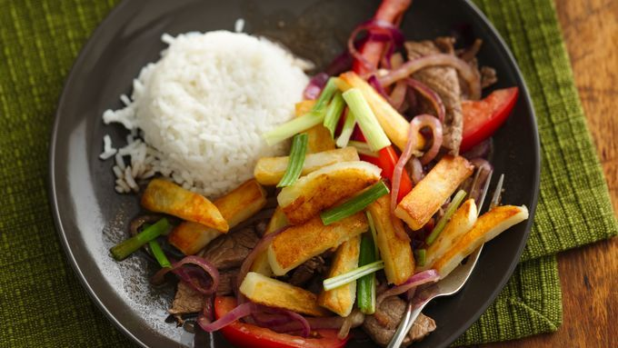 Looking for a wonderful dinner? Then check out this Peruvian-style vegetable and beef stir-fry that's served over rice.