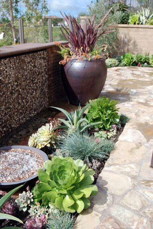 the soothing sound and look of a fountain provides the finishing touch to any garden setting