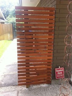 """side """"fences"""" to hide trash cans. 