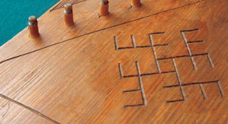 Kokle Latvian Swastika motif