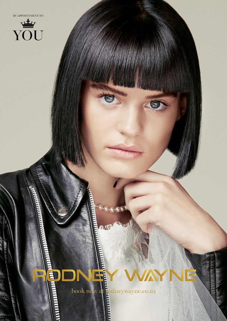 HANNAH Demure and strong, this chic bob in darkest brown shines and shimmers with cool mulberry tones. Worn straight for the duties of office, hiding the severe undercut it is both classic and cool. Or twist it up into 90's inspired topknots for radical change of character. The gloriously short fringe brings attention to the eyes and opens up your face for a modern, yet timeless look.