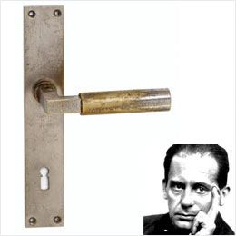 """Door handles were among the many things that Walter Gropius designed. This is the """"famed Gropius door handle"""" first produced in 1923. It is reproduced today by only one company, Tecnoline, the only company  authorized by his heirs. Gropius' handles were available in various angular and rounded plates. I selected this because it shows that in keeping with Bauhaus philosophy, every aspect of the house, even a door handle, was """"planned for simplicity of design."""""""