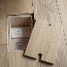Recessed floor plugs with wood covers. This make so much sense!
