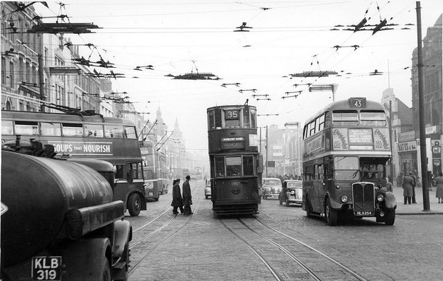 Holloway Road at Nag's Head showing left to right : a trolley bus, a tram and a diesel bus. Also note the overhead power lines and the tramlines. the tall building far right is the now demolished Malborough Cinema. (photograph from the Warsaw 1948 collection)