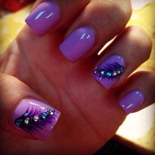 Neon purple nails with feathers
