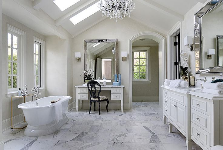 love the mirrors in this bathroom, with the white marble floors....would redo the cabinetry