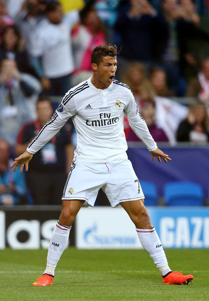 Cristiano Ronaldo of Real Madrid celebrates after scoring the opening goal during the UEFA Super Cup between Real Madrid and Sevilla FC at Cardiff City Stadium on August 12, 2014 in Cardiff, Wales.
