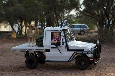 His dad is the best. Kid sized Landcruiser Ute. Love it!!!!