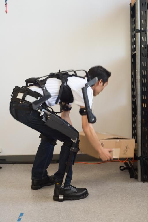 Nate Poon demonstrating the combined legX, backX and shoulderX modules of the MAX (Modular Agile eXoskeleton) by SuitX,