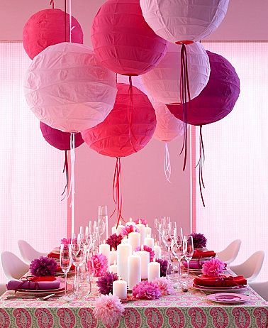 Different shades of pink, paper lanterns and flowers; could use plastic wine glasses with sparkling grape juice to let the girls feel a little more grown up
