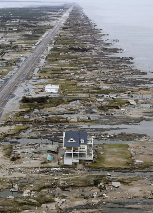 A single home is left standing among debris from Hurricane Ike September 14, 2008 in Gilchrist, Texas.