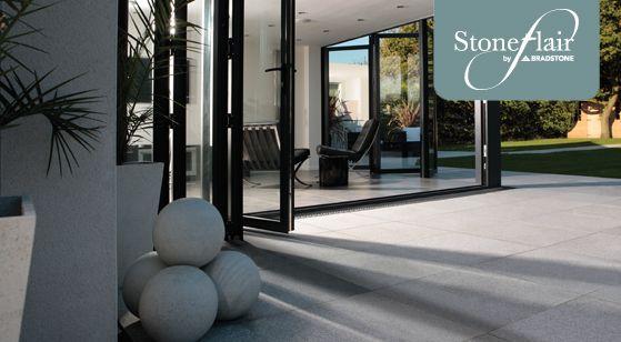 bi fold patio doors opening onto large patio terrace | Bradstone Natural Granite Paving Stone