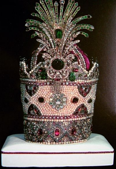 Kiani Crown - Iranian Crown Jewels  This crown was the traditional coronation crown of the Qajar dynasty, which lasted from 1796 - 1925. A new crown was created for the next dynasty, the Pahlavi dynasty, although this crown was present at the first coronation in 1926. The Kiani Crown is made of red velvet and is decorated with thousands of gems. There are around 1800 pearls, 1800 rubies and 300 emeralds stitched into the crown, which is 12.5 inches tall and 7.5 inches wide.