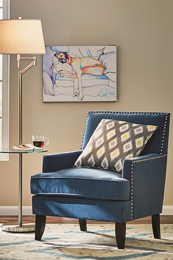 This blue accent chair with nail head trim is a fun pop of color to a contemporary family living room.