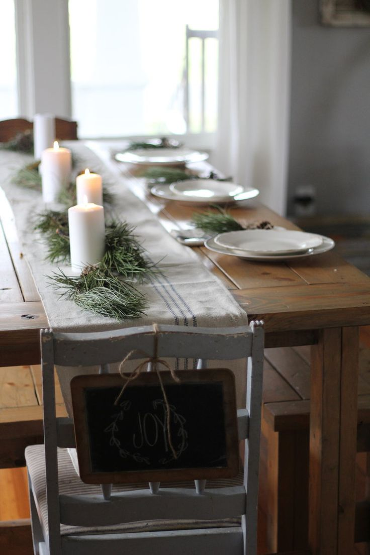 Thank you so much for stopping by our little farmhouse to see it all decked  out for Christmas. I decided to keep it very simple this year, with fresh  greenery, grain sack, candles and knit pillows and blankets. Welcome to  our Farmhouse on Boone. I am so glad you're here.  I cozied up the kitchen with candles and fresh greenery. I had so much fun  making wreathes from different greens that I came across.  I am loving my new lights above the sink that I purchased from Lamps Plus.  I made…