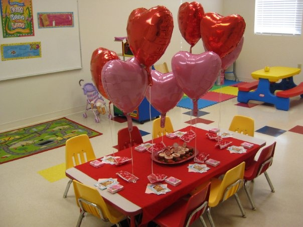 """Have a """"Jesus Loves Me"""" party for your Sunday school class on the Sunday closest to Valentine's Day! We have done this for years and we take a photo of each child holding a large Valentine Heart that says """"Jesus Loves Me"""" We e-mail the photo to the child's parents and we also process it, glue it on a heart and give it to the child."""