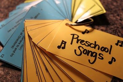 Pick about 45 of your favorite kid songs & nursery rhymes, print on cardstock, cut out, laminate, put on key ring.