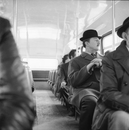 A City gent on the top deck of a London bus: 20th century, Henry Grant