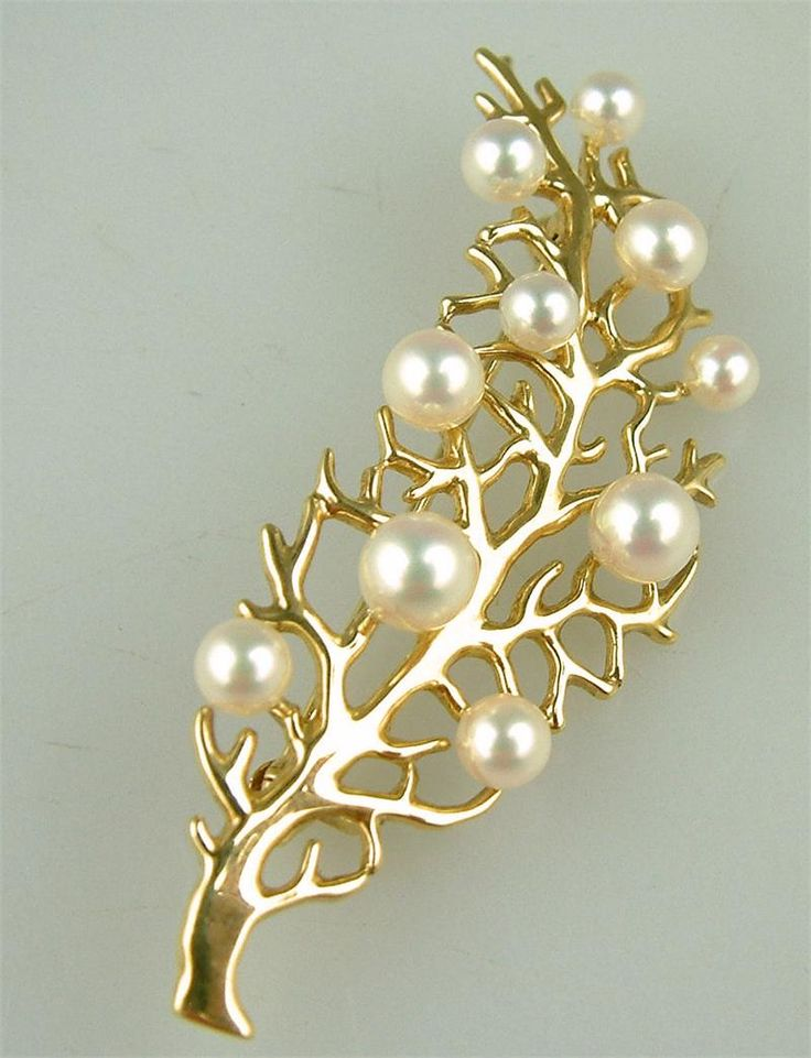 Designer gold and pearl brooch