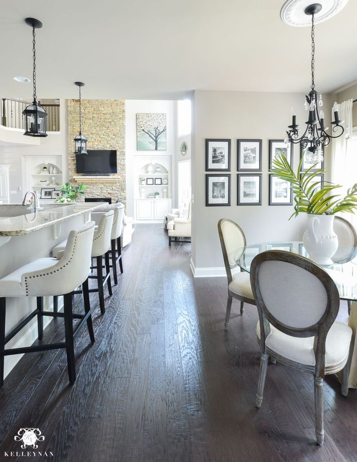 Shades of Summer Home Tour with Neutrals and Naturals-kitchen nook with bar stools and black and white gallery wall