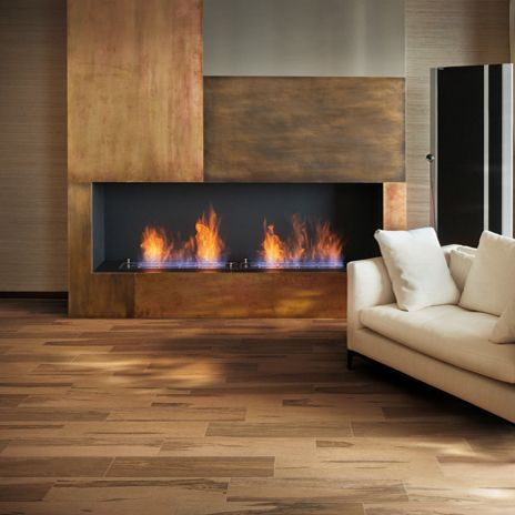 Imagine watching this spectacular fire with this fantastic floor that looks like wood but it is Over Sienna porcelain tile by arizonatile.com!