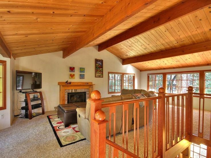 Wooden Ceilings with bright white walls, and fireplaces in more than one room.