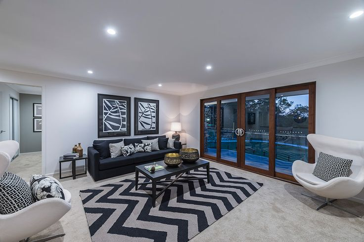 #Living-room #interior #design #inspiration from #Ausbuild's Newbury display home. This #living-room features a statment chevron rug combined with a signature white chairs and #earthy #furnishings.