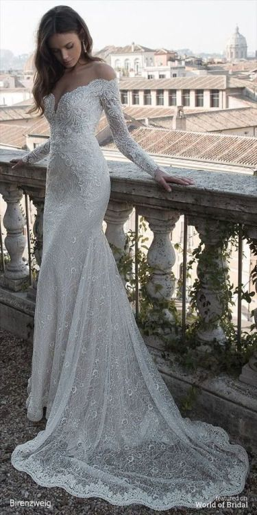 Off the shoulder long sleeved lace wedding dress