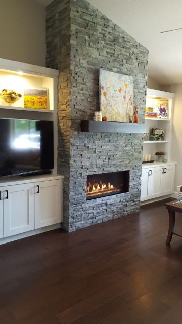 Gas fireplace addition | ledgestone fireplace and white shaker cabinets
