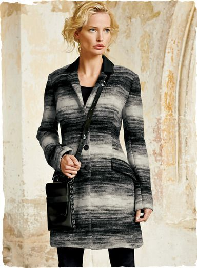 A cozy embrace of felted Italian wool (78%) and polyester (22%), this gorgeously graphic coat is woven in salt and pepper bands. Tailored to fit and flare, and detailed with a black collar, contoured seaming, flap pockets and deep back vent. Fully lined.