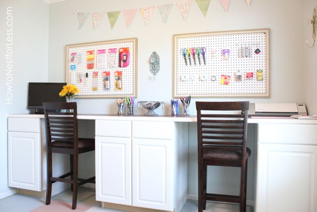 Craft desk area of multi-purpose room.  Worktop + cabinets for storage.  Could later be kids' homework area.