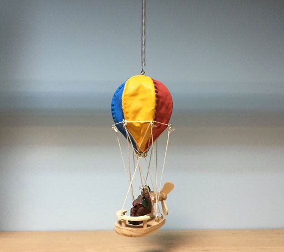 Hanging mobile colorful hot air balloon with pilot manwooden